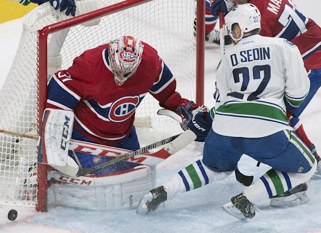 Montreal Canadiens goaltender Carey Price makes a save against Vancouver Canucks' Daniel Sedin during the second period of an NHL hockey game Thursday, Feb. 6, 2014, in Montreal. (AP Photo/The Canadian Press, Graham Hughes)