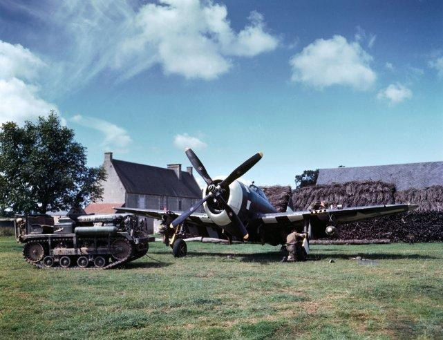 """Maintenance work on an American P-47 Thunderbolt in a makeshift airfield in the French countryside, summer 1944. (Frank Scherschel—Time & Life Pictures/Getty Images) <br> <br> <a href=""""http://life.time.com/history/d-day-rare-color-photos/#1"""" rel=""""nofollow noopener"""" target=""""_blank"""" data-ylk=""""slk:Click here"""" class=""""link rapid-noclick-resp"""">Click here</a> to see the full collection at LIFE.com"""