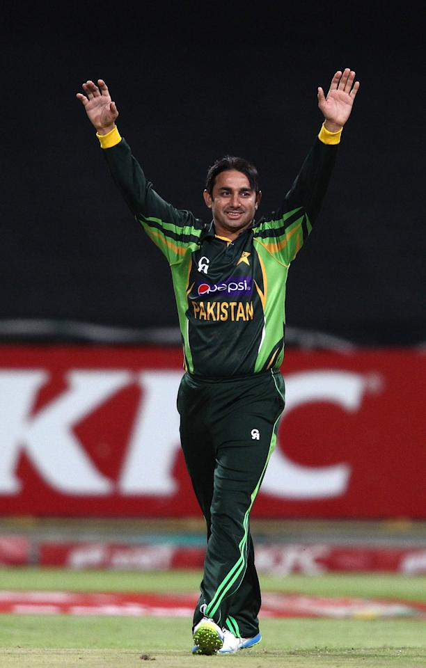 CAPE TOWN, SOUTH AFRICA - NOVEMBER 22: Saeed Ajmal of Pakistan celebrates getting Hashim Amla of South Africa wicket during the 2nd T20 International match between South Africa and Pakistan at Sahara Park Newlands on November 22, 2013 in Cape Town, South Africa. (Photo by Shaun Roy/Gallo Images/Getty Images)