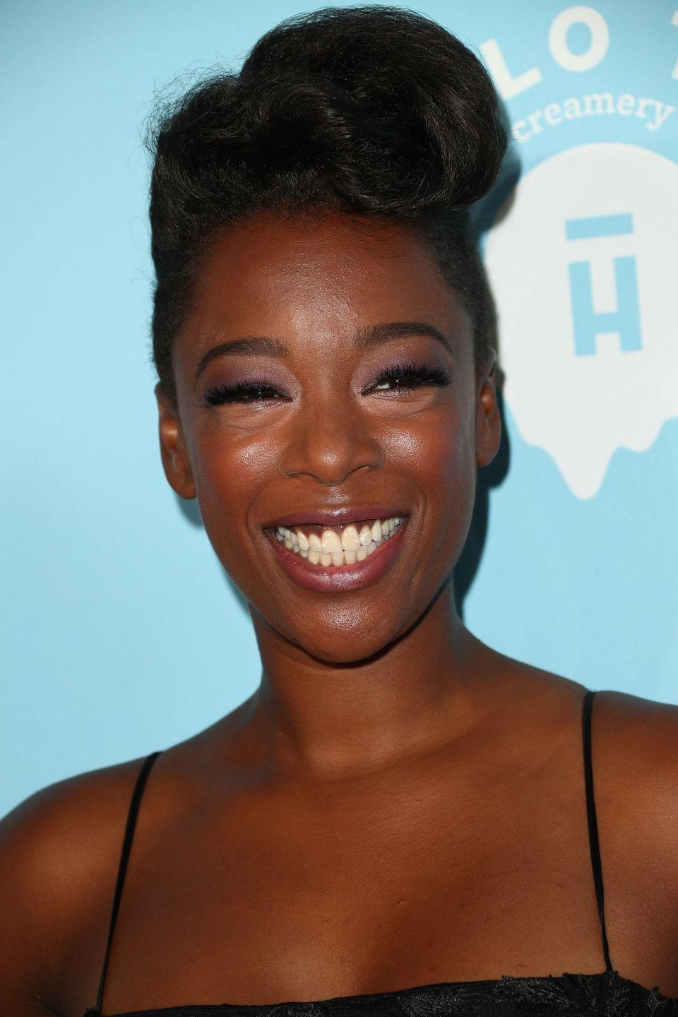 """<p><em>Orange Is The New Black</em> actress <strong>Samira Wiley</strong> is showstopping in a tapered updo. <a href=""""https://www.goodhousekeeping.com/beauty/hair/tips/a25691/how-to-blow-dry-hair/"""" rel=""""nofollow noopener"""" target=""""_blank"""" data-ylk=""""slk:Blow out"""" class=""""link rapid-noclick-resp"""">Blow out</a> your <a href=""""https://www.goodhousekeeping.com/beauty-products/g34894772/best-flat-irons-for-natural-hair/"""" rel=""""nofollow noopener"""" target=""""_blank"""" data-ylk=""""slk:natural hair"""" class=""""link rapid-noclick-resp"""">natural hair</a> and twist it up to create <a href=""""https://www.goodhousekeeping.com/beauty/hair/tips/g1800/celebrity-hairstyles-updo/"""" rel=""""nofollow noopener"""" target=""""_blank"""" data-ylk=""""slk:a beautiful updo"""" class=""""link rapid-noclick-resp"""">a beautiful updo</a> that allows the focus to be on your face. </p>"""