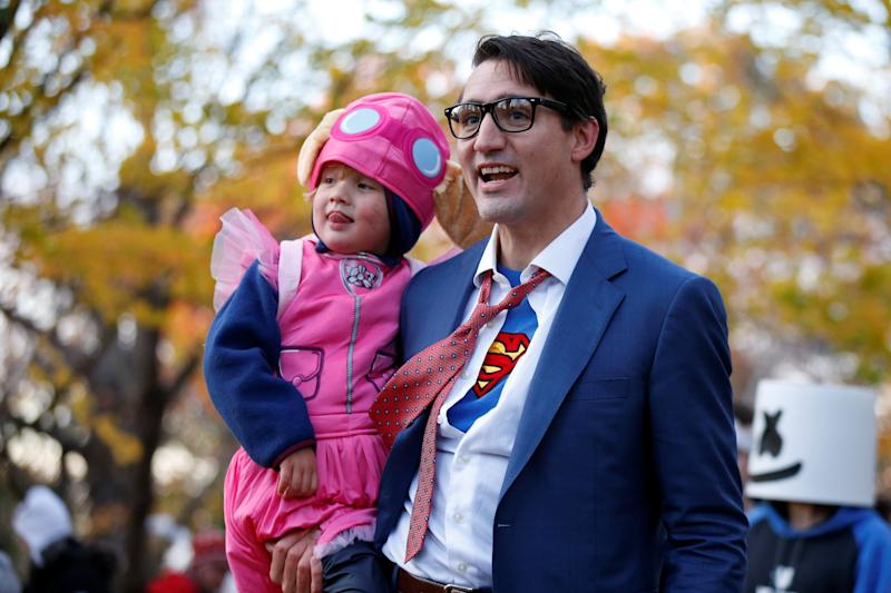 Justin Trudeau carries his son Hadrien while participating in Halloween festivities at Rideau Hall in Ottawa, Ontario, Canada on Oct. 31. (Chris Wattie / Reuters)
