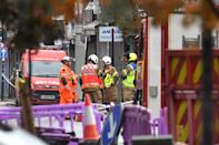 "Emergency services at the scene of a suspected gas explosion on King Street in Ealing, west London. Rescuers are involved in a ""complex"" search for anyone who may still be inside the collapsed building."