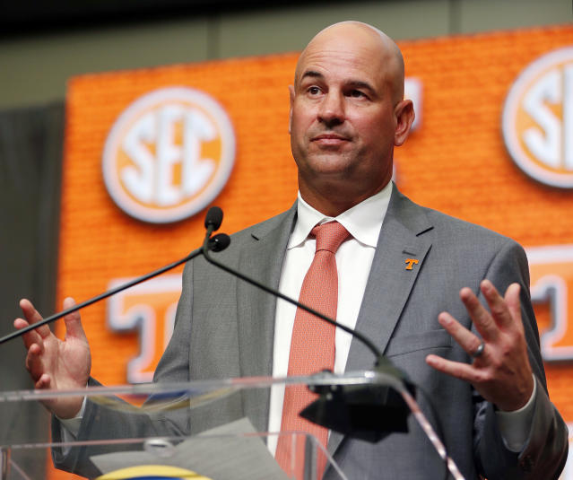 FILE - In this July 18, 2018, file photo, Tennessee NCAA college football head coach Jeremy Pruitt speaks during Southeastern Conference Media Days in Atlanta. Pruitt committed a minor NCAA violation earlier this year by tweeting out his congratulations when the high school he attended won an Alabama state basketball title. The tweet was deleted 37 minutes later, after a compliance official noted that it constituted an impermissible endorsement of a high school team and its coach. (AP Photo/John Bazemore, File)