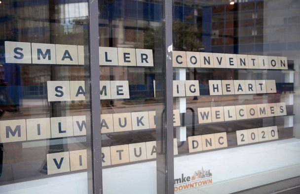 PHOTO: A sign in a storefront near the Wisconsin center welcomes visitors to the city on Aug. 17, 2020, the first day of the Democratic National Convention, in Milwaukee. (Scott Olson/Getty Images)