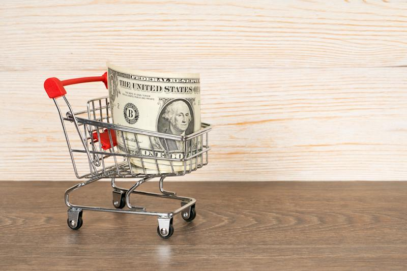 A dollar bill in a shopping cart.