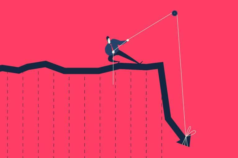 Businessman pulling rope trying to lift up falling graph.