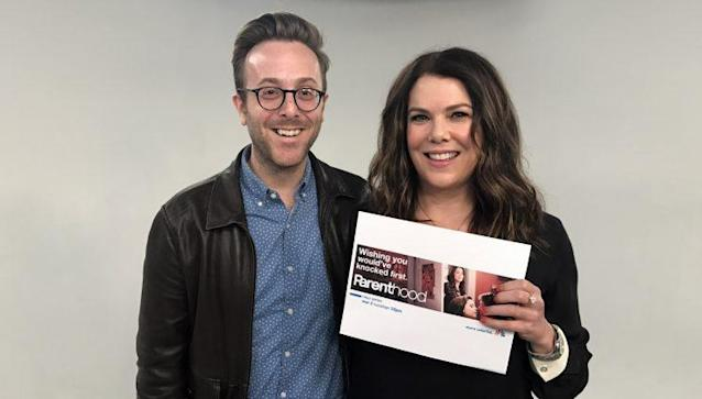 Me standing next to Lauren Graham, who is holding a picture of Graham standing near me (Photo Credit: Yahoo)