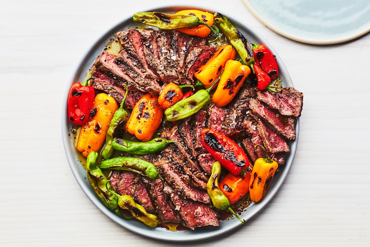 "Quickly charred shishito peppers and mixed mini sweet peppers flavored with just salt, pepper, and olive oil are a sweet and smoky topping for grilled strip steaks. <a href=""https://www.epicurious.com/recipes/food/views/grilled-steak-and-mixed-peppers?mbid=synd_yahoo_rss"">See recipe.</a>"