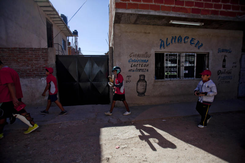 Caacupe cricket team players walk to a training session inside the Villa 21-24 slum in Buenos Aires, Argentina, Saturday, March 22, 2014. The International Cricket Council has recognized the team, formed from the children of the Villa 21-24 shantytown, honoring them as a global example for expanding the sport, which in certain countries, like India, is widely played, but in many parts of the world restricted to elite sectors of society. Introducing cricket in the slum began in 2009 as an idea to transform the game into a social integration mechanism, before that it rarely breached the gates of the country's upscale private schools. (AP Photo/Natacha Pisarenko)