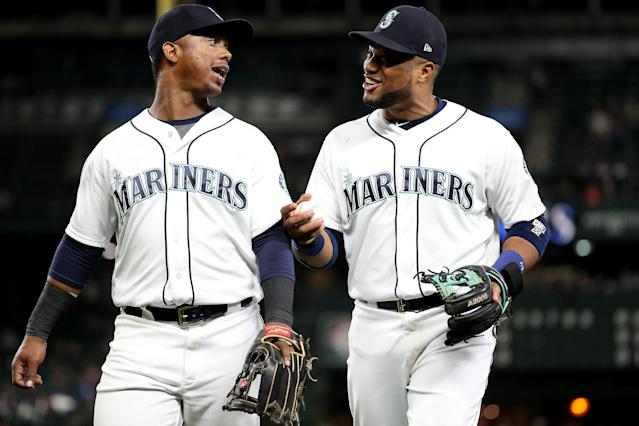 As part of a rebuild, the Seattle Mariners traded Jean Segura (left) to Philadelphia and Robinson Cano (right) to the New York Mets. (Getty Images)