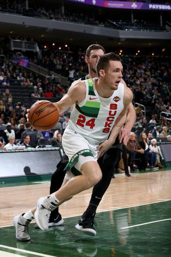 MILWAUKEE, WI - JANUARY 1: Pat Connaughton #24 of the Milwaukee Bucks drives to the basket during the game against the Detroit Pistons on January 1, 2019 at the Fiserv Forum Center in Milwaukee, Wisconsin. (Photo by Gary Dineen/NBAE via Getty Images)