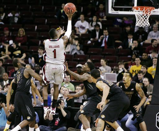 South Carolina's Brenton Williams shoots a 3-pointer against Missouri during the first half of their NCAA college basketball game, Thursday, Feb. 28, 2013, in Columbia, S.C. (AP Photo/Mary Ann Chastain)
