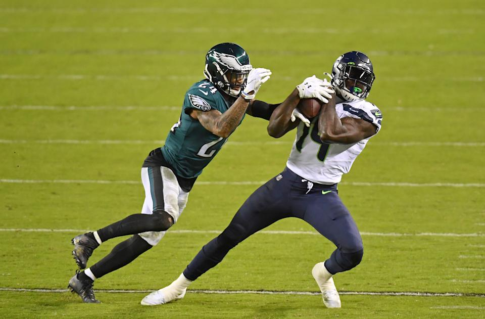 Nov 30, 2020; Philadelphia, Pennsylvania, USA; Seattle Seahawks wide receiver DK Metcalf (14) makes a catch against Philadelphia Eagles cornerback Darius Slay (24) during the third quarter at Lincoln Financial Field. Mandatory Credit: Eric Hartline-USA TODAY Sports
