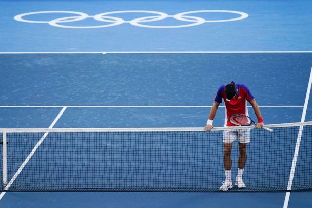PHOTO: Novak Djokovic, of Serbia, reacts after being defeated by Pablo Carreno Busta, of Spain, in the bronze medal match of the tennis competition at the 2020 Summer Olympics, Saturday, July 31, 2021, in Tokyo, Japan. (Seth Wenig/AP Photo)