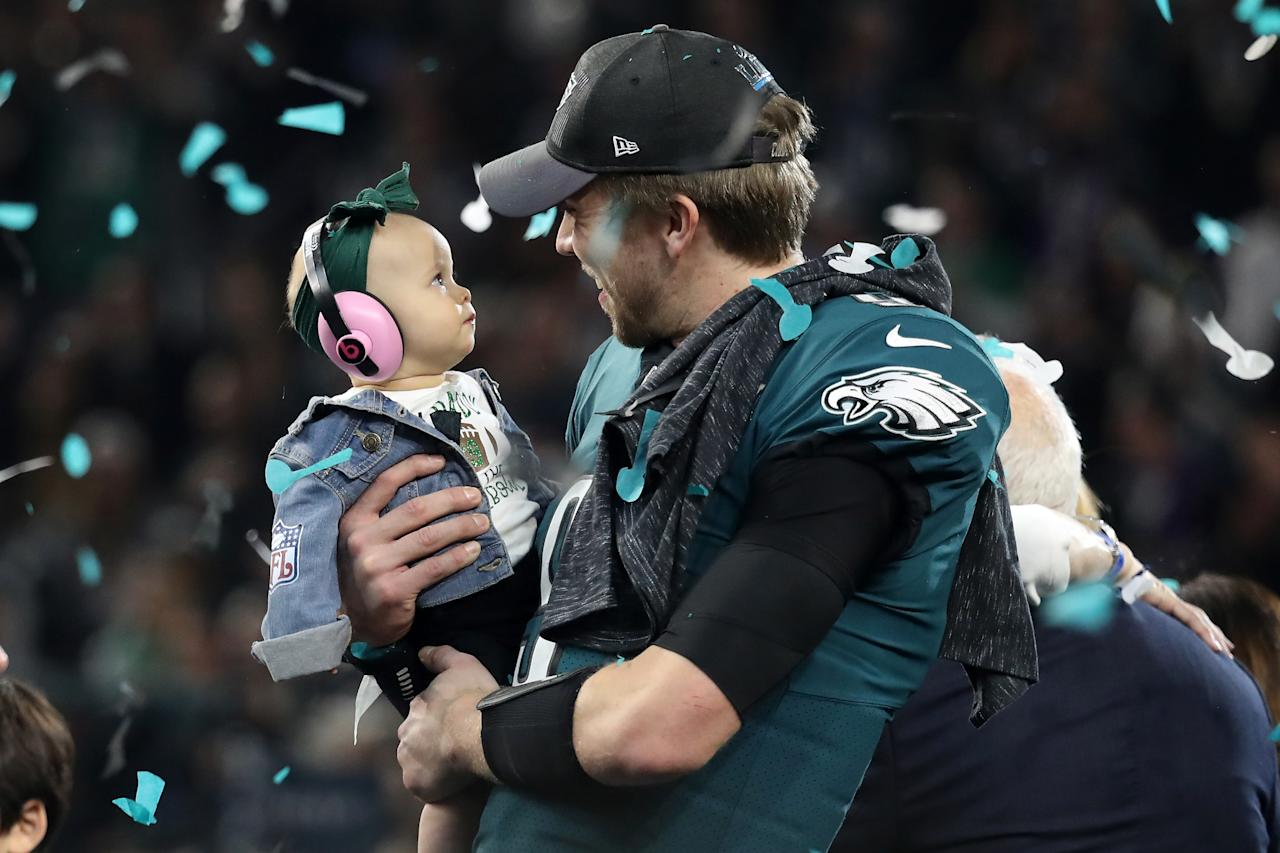 <p>Nick Foles #9 of the Philadelphia Eagles celebrates with his daughter Lily Foles after his 41-33 victory over the New England Patriots in Super Bowl LII at U.S. Bank Stadium on February 4, 2018 in Minneapolis, Minnesota. The Philadelphia Eagles defeated the New England Patriots 41-33. (Photo by Rob Carr/Getty Images) </p>