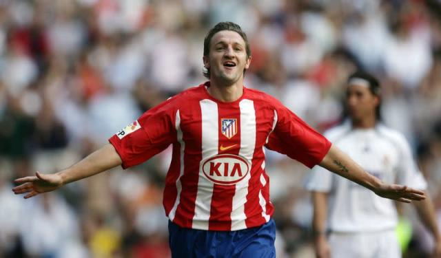Atletico Madrid's Mista celebrates his goal against Real Madrid during their Spanish First Division soccer match in Madrid