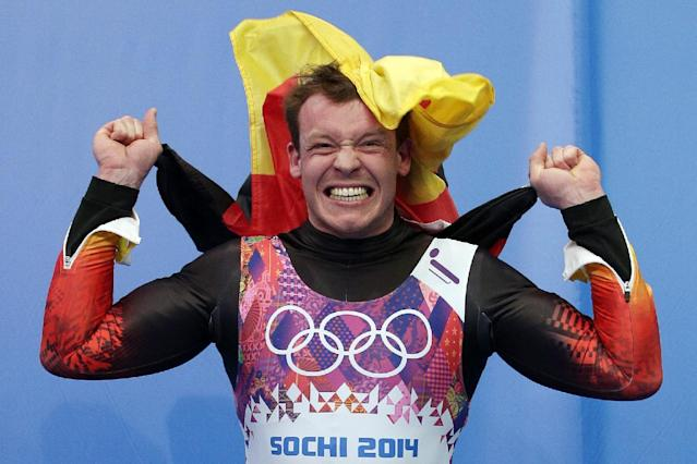 Felix Loch of Germany jumps onto the podium after he won the gold medal during the men's singles luge final at the 2014 Winter Olympics, Sunday, Feb. 9, 2014, in Krasnaya Polyana, Russia. (AP Photo/Michael Sohn)