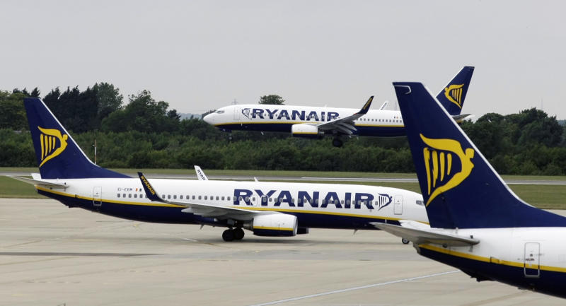 FILE- In this Tuesday July 21, 2009 file photo, Ryanair planes are seen at Stansted Airport in England. Ryanair chief executive Michael O'Leary says the 18 percent drop in sterling's value since Britain voted in June to leave the European Union has hit the euro value of 26 percent of the airline's sales. As a result, he said Tuesday, Oct. 18, 2016, Ryanair's fiscal 2017 forecast was being cut by 5 percent to a new range of 1.3 billion euros to 1.35 billion euros ($1.43 billion to $1.49 billion), still 7 percent better than in 2016. (AP Photo/Matt Dunham, File).