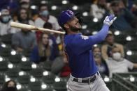 Chicago Cubs' Chicago Cubs' Kris Bryant hits an RBI sacrifice fly during the fourth inning of a baseball game against the Milwaukee Brewers Tuesday, April 13, 2021, in Milwaukee. (AP Photo/Morry Gash)