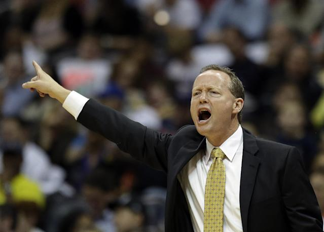 Atlanta Hawks head coach Mike Budenholzer directs his players from the bench in the second half of an NBA basketball game against the Toronto Raptors, Friday, Nov. 1, 2013, in Atlanta. (AP Photo/John Bazemore)