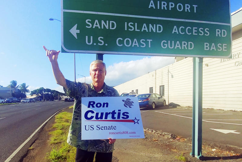 In this Oct. 16, 2018 photo provided by the Curtis For Senate campaign, Hawaii Republican candidate for the U.S. Senate Ron Curtis waves at commuters on Nimitz Highway in Honolulu. He is running against incumbent Democrat Mazie Hirono. (Ahava Lee Lane/Curtis For Senate via AP)