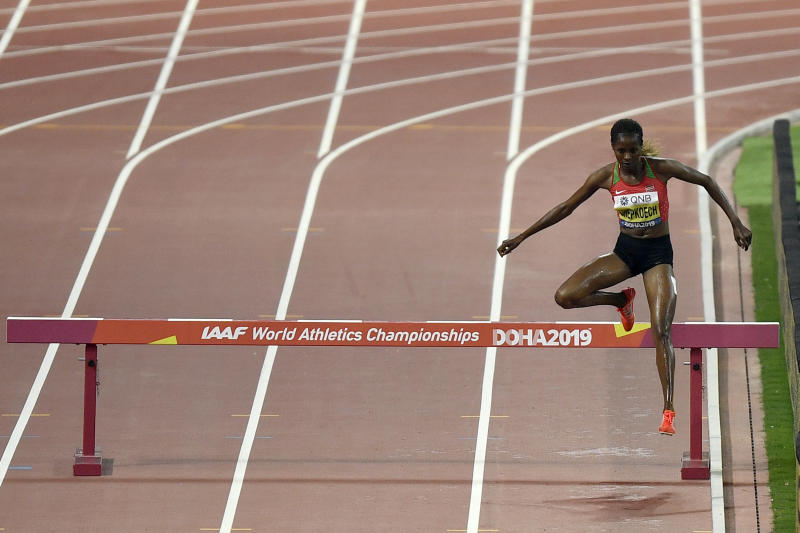 Beatrice Chepkoech, of Kenya,competes in the women's 3000 meter steeplechase final during the World Athletics Championships in Doha, Qatar, Monday, Sept. 30, 2019. (AP Photo/Martin Meissner)