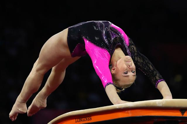 Angelina Melnikova of Russia performs on the vault in the women's all-around final at the Gymnastics World Championships in Stuttgart, Germany, Thursday, Oct. 10, 2019. (AP Photo/Matthias Schrader)