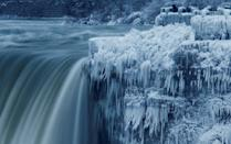<p>A lone visitor takes a picture near the brink of the ice-covered Horseshoe Falls in Niagara Falls, Ontario, Canada, January 3, 2018. REUTERS/Aaron Lynett </p>