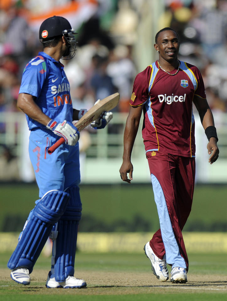 Dwayne Bravo captain of West Indies exchanges a word with Virat Kholi of India during the second Star Sports One Day International (ODI) match between India and The West Indies held at the Dr. Y.S. Rajasekhara Reddy ACA-VDCA Cricket Stadium, Vishakhapatnam, India on the 24th November 2013  Photo by: Pal Pillai - BCCI - SPORTZPICS   Use of this image is subject to the terms and conditions as outlined by the BCCI. These terms can be found by following this link:  https://ec.yimg.com/ec?url=http%3a%2f%2fsportzpics.photoshelter.com%2fgallery%2fBCCI-Image-Terms%2fG0000ahUVIIEBQ84%2fC0000whs75.ajndY&t=1490620038&sig=8exHWB0wWbNieMsXi7ucig--~C