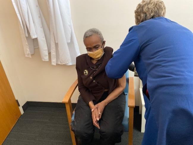 Ms. Jackson receives her COVID-19 vaccine as part of CUHCC's community outreach efforts.