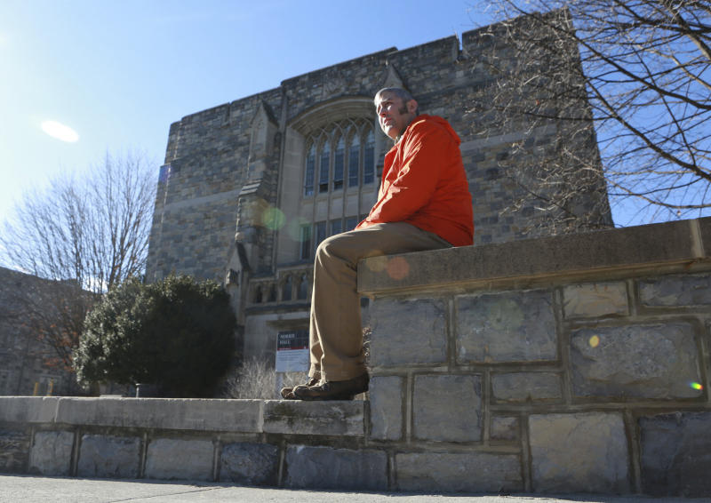 Kevin Sterne sits in front of Norris Hall on the Virginia Tech campus in Blacksburg Va. Thursday March 2 2017. Sterne was in Norris Hall at Virginia Tech 10 years ago when a gunman walked in and started shooting. (Matt Gentry/The Roanoke Times via AP)