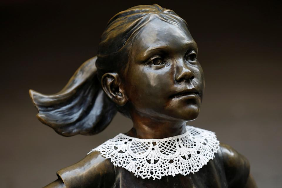 A jabot collar is seen placed on the Fearless Girl statue in honor of recently passed Associate Justice of the Supreme Court of the United States Ruth Bader Ginsburg in Manhattan, New York City, U.S., September 21, 2020. REUTERS/Andrew Kelly