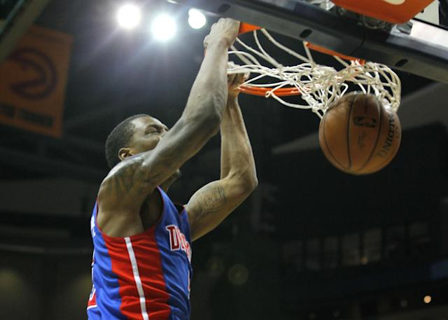 Detroit Pistons guard Kentavious Caldwell-Pope (5) goes up for the slam in the second period of an NBA basketball game against the Atlanta Hawks in Atlanta, Tuesday, April 8, 2014. (AP Photo/Todd Kirkland)