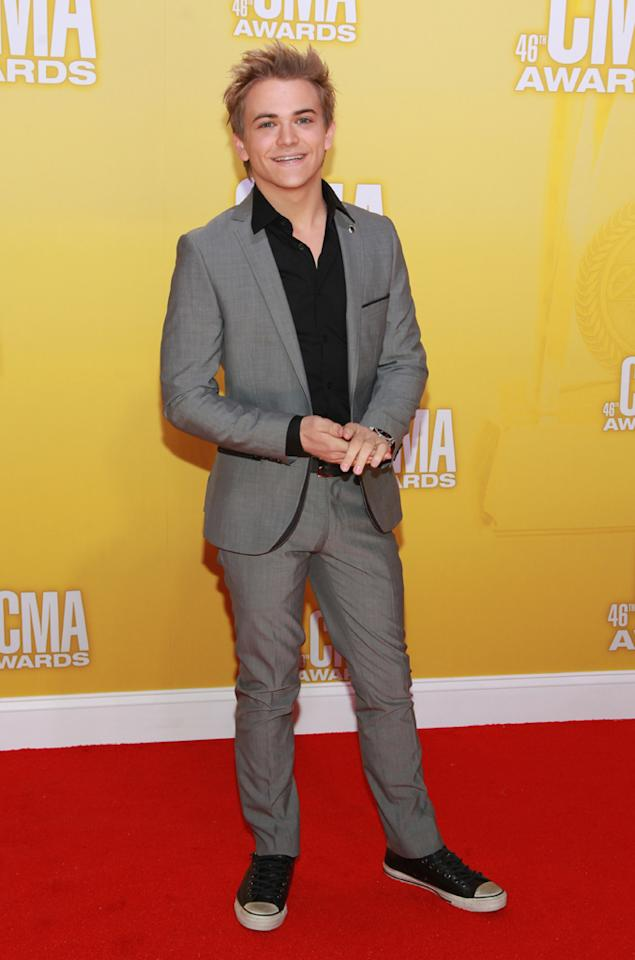 "<p class=""MsoNormal""><span style=""color:black;"">New Artist of the Year nominee Hunter Hayes dressed up his dirty Converse sneakers with a crisp gray suit and button-down black shirt. But what else would you expect from a 21-year-old? Whether or not Hunter goes home with a CMA, he's still a winner: he's been opening up for Carrie Underwood on her ""Blown Away"" world tour. (11/1/2012)<br></span></p>"