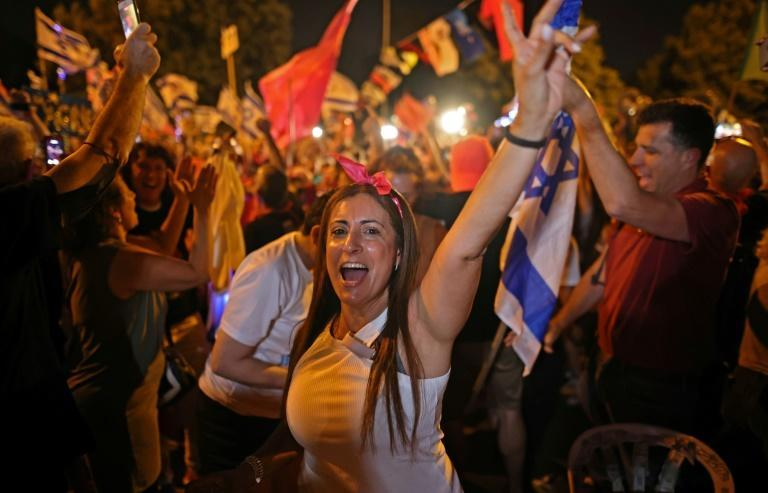 Israelis in front of the Knesset (parliament) in Jerusalem celebrate the toppling of longtime prime minister Benjamin Netanyahu