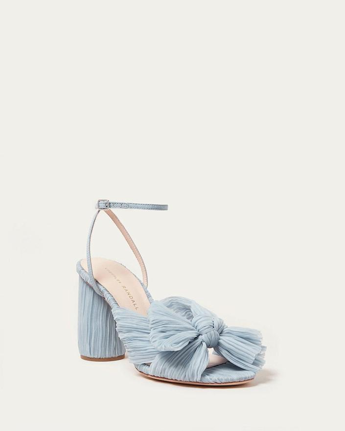 """<p>The <span>Loeffler Randall Camellia Blue Bow Heel</span> ($395) can be a bride's something blue, as well as a """"Cinderella slipper.""""</p>"""
