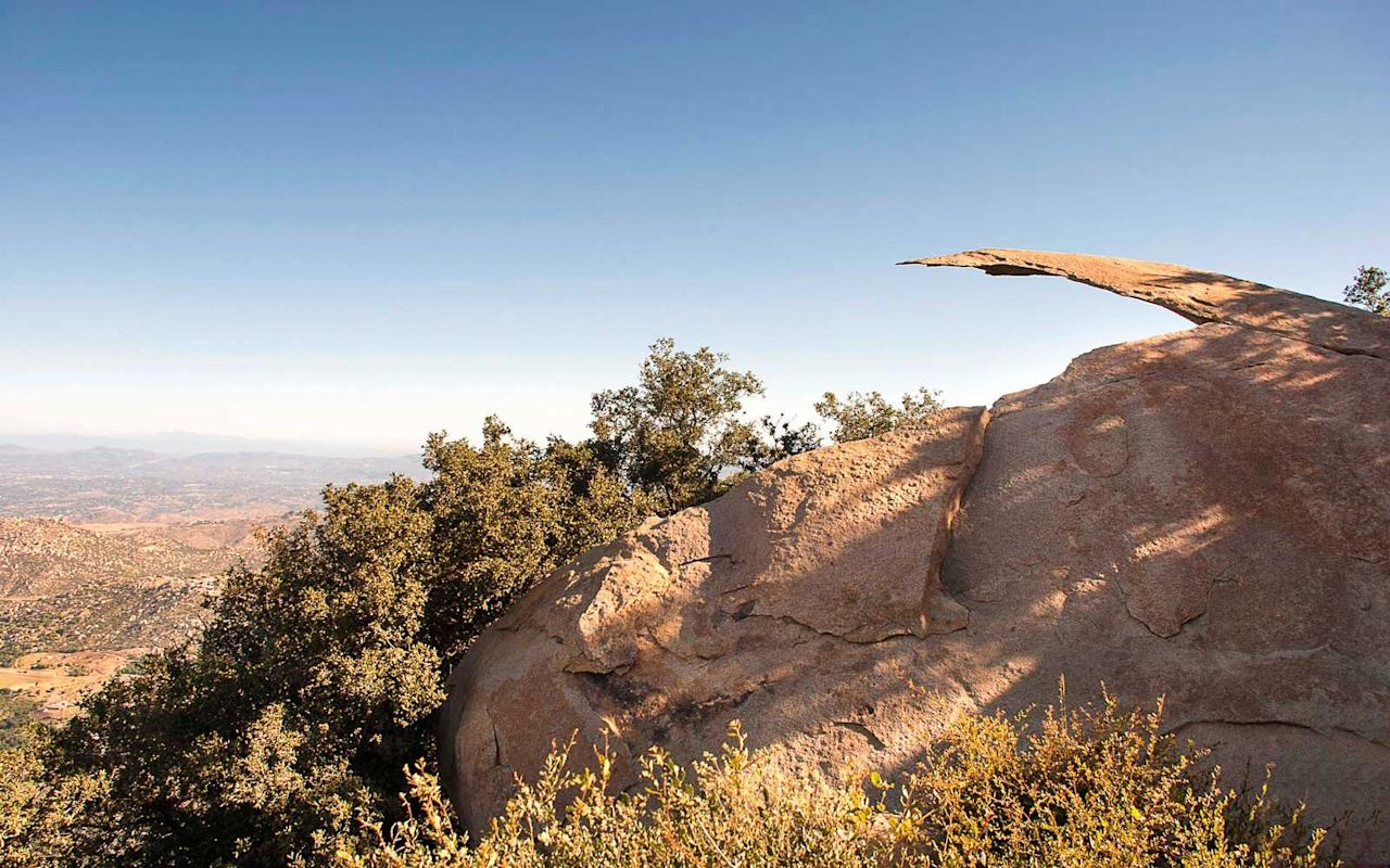 "<p>Famed home of Potato Chip Rock, the Mt. Woodson Summit hiking trail is an <a href=""https://www.travelandleisure.com/photography/lauren-bath-instagram-photos"">adventure-gram</a> moment if ever there was one. (Because Potato Chip Rock extends out over nothingness, it's become a classic southern California photo op.) The Mt. Woodson hike is a challenging seven-and-a-half miles and yields one breathtaking view after another. There are steep inclines, but on the plus side, it's dog-friendly, so you can bring a furry companion to cheer you on.</p>"