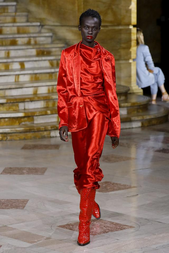 """What can I say? I freaking loved Sies Marjan's Spring 2020 show. I wasn't able to capture all of the #content on my phone, because it was on 1%, but that might have been a blessing in disguise as I was truly able to take in all of the beauty. Designer Sander Lak <a href=""""https://www.vogue.com/fashion-shows/spring-2020-ready-to-wear/sies-marjan?mbid=synd_yahoo_rss"""">told</a> <em>Vogue</em>, that his intention this season was to """"try out an earnest, pure, genuine beauty,"""" and he delivered. From the denim suit to all-yellow look, it wasn't only a showcase in beauty, but a lesson in color theory. This head-to-toe red look was my favorite from the show, using textures to make wearing one color feel. A silky skirt and cowl-neck top, satin blazer, and croc riding boots --- all red, and then to top it off is the glossy red lip. Hello, 2020, I'll be wearing this (or something like this) next spring. -- Tahirah Hairston, Fashion and Beauty Director."""