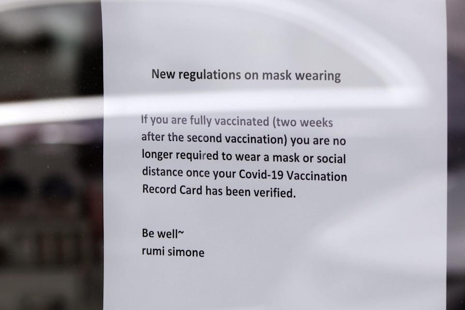 A sign at a spa and beauty salon in Lake Oswego, Oregon on Friday, May 21, 2021, advises that only customers who can prove they are fully vaccinated may enter without masks on.