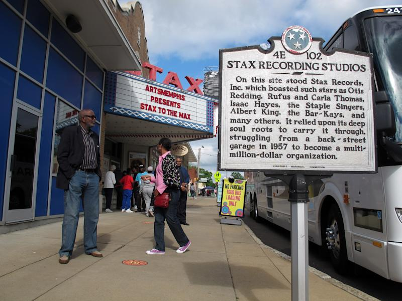 """In this Monday, April 29, 2013 photo, a plaque marks the spot of the former Stax Records music studio, which has been rebuilt into the Stax Museum of American Soul Music, in Memphis, Tenn. Next to the museum sits the Stax Music Academy. an after-school program where teenagers from some of Memphis' poorest neighborhoods learn how to dance, sing and play instruments. The academy's students play annual shows in Memphis and have toured to Washington, Italy and Australia, helping spread the soulful """"Memphis Sound."""" (AP Photos/Adrian Sainz)"""
