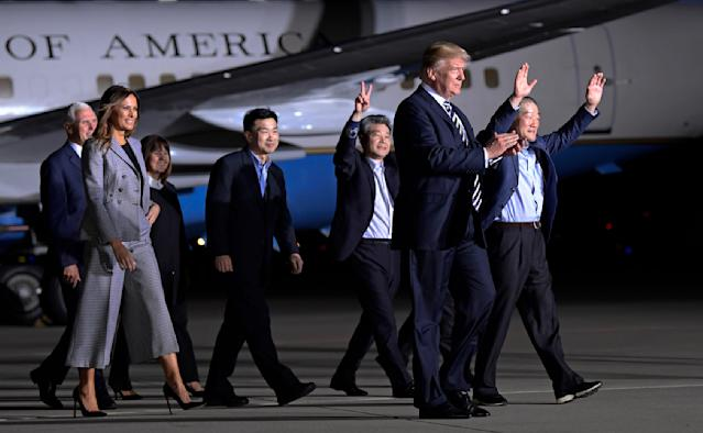 <p>President Donald Trump walks with Tony Kim, fourth right, Kim Hak-song, third right, Kim Dong- chul, right, the three Americans detained in North Korea for more than a year as they arrive at Andrews Air Force Base in Md., Thursday, May 10, 2018. Walking with Trump is Vice President Mike Pence, left, and first lady Melania Trump. (Photo: Susan Walsh/AP) </p>