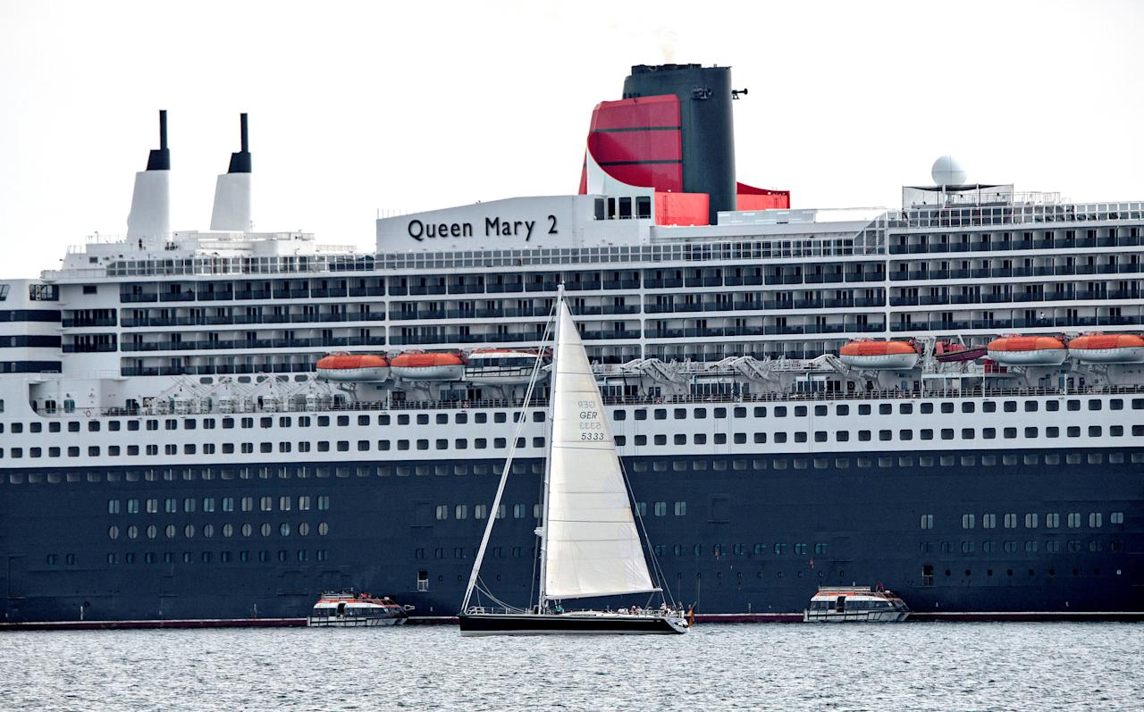 Queen Mary 2 cruise ship is seen moored in Elsinore, Denmark August 14, 2018. Ritzau Scanpix/Keld Navntoft via REUTERS ATTENTION EDITORS - THIS IMAGE WAS PROVIDED BY A THIRD PARTY. DENMARK OUT. NO COMMERCIAL OR EDITORIAL SALES IN DENMARK.  Ritzau Scanpix/via REUTERS    ATTENTION EDITORS - THIS IMAGE WAS PROVIDED BY A THIRD PARTY. DENMARK OUT. NO COMMERCIAL OR EDITORIAL SALES IN DENMARK.