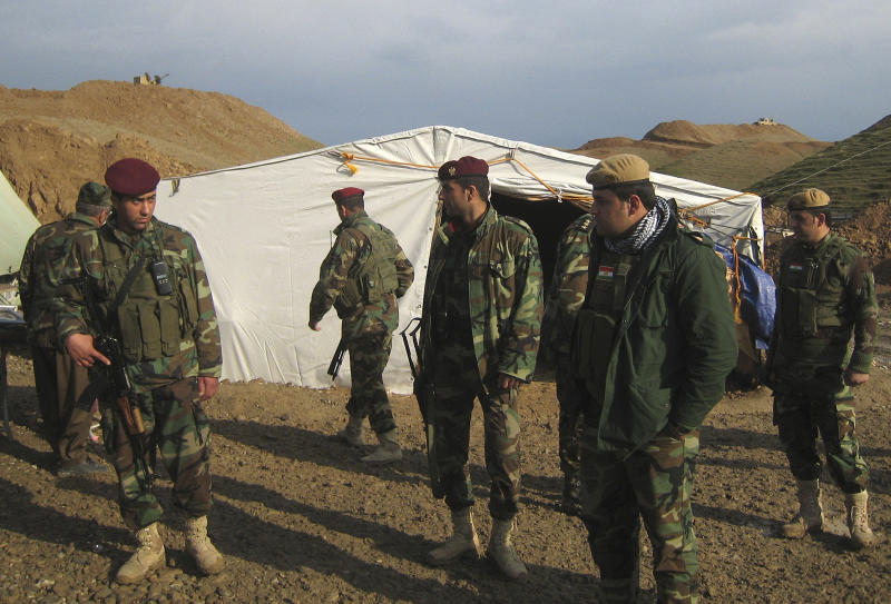 In this Dec. 11, 2012 Peshmerga members gathering in a Kurdish military camp at the outskirts of Kirkuk, in Kirkuk, 290 kilometers (180 miles) north of Baghdad, Iraq. (AP Photo/Emad Matti)