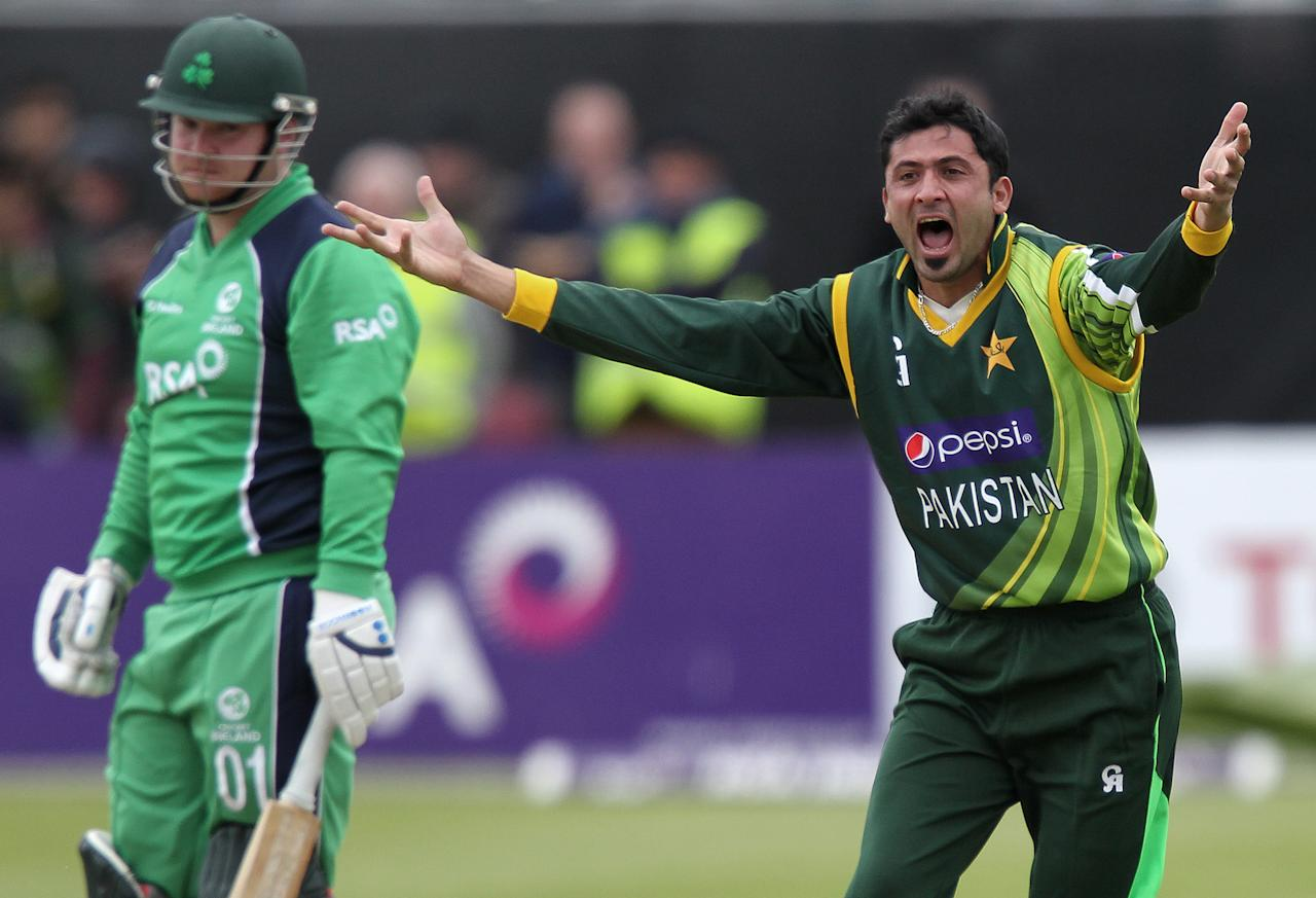 Pakistan's Junaid Khan (R) disputes a call as Ireland's Paul Stirling (L) looks on during the One Day International (ODI) cricket match between Pakistan and Ireland at Clontarf Cricket Club in Dublin on May 23, 2013.