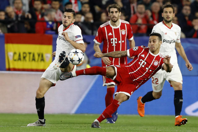 Sevilla's Pablo Sarabia, left, and Bayern's Thiago challenge for the ball during the Champions League quarter final first leg soccer match between Sevilla FC and FC Bayern Munich at the Sanchez Pizjuan stadium in Seville, Spain, Tuesday, April 3, 2018. (AP Photo/Miguel Morenatti)