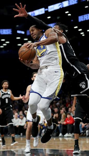 Rondae Hollis-Jefferson of the Brooklyn Nets defends against Andre Iguodala of the Golden State Warriors at Barclays Center
