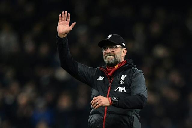 High five: Jurgen Klopp's Liverpool remain on course to win five trophies this season (AFP Photo/Glyn KIRK )