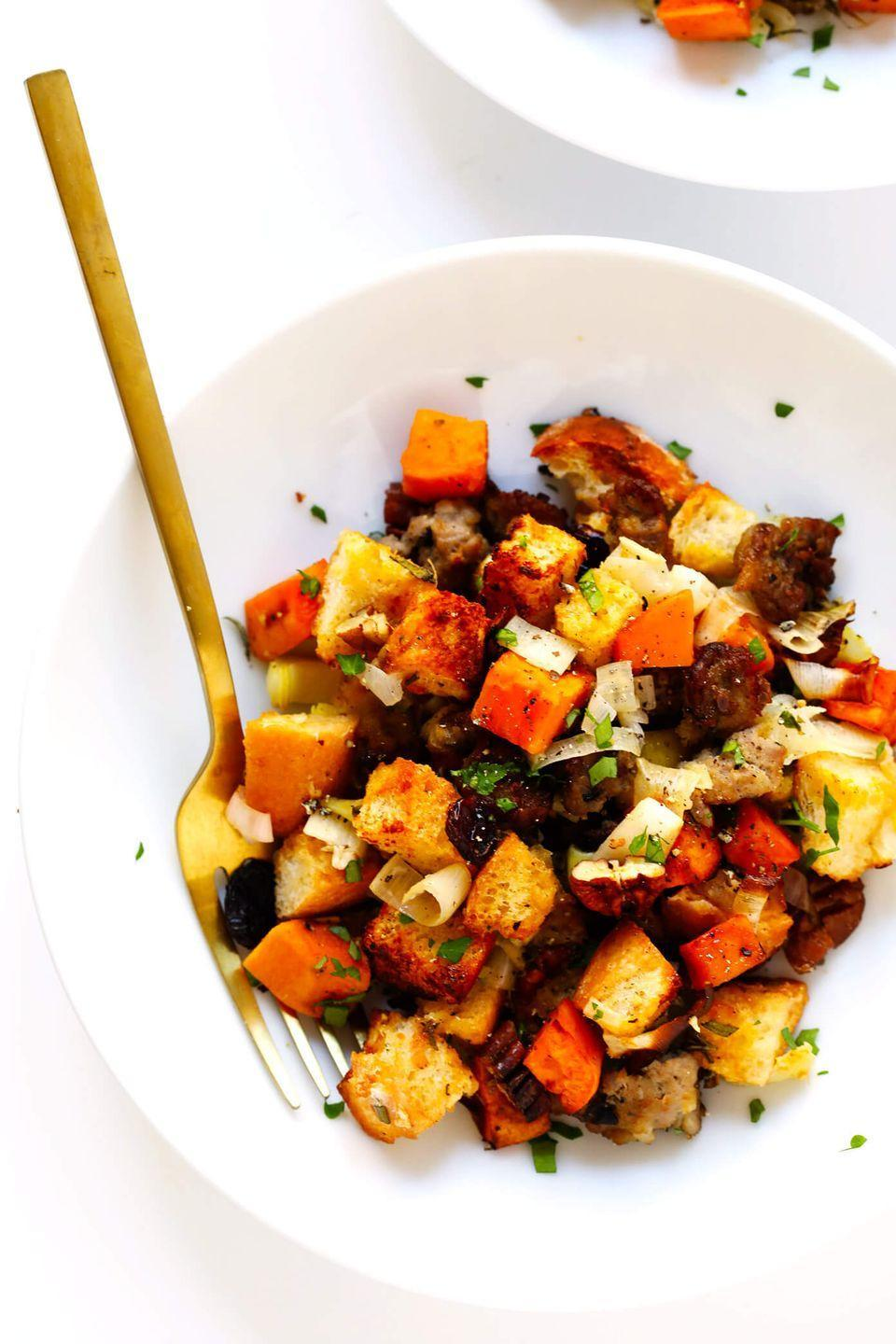 """<p>Don't you worry — there's still plenty of thick, crusty bread in here, along with sweet potatoes, pecans, cranberries, and veggies.</p><p>Get the recipe from <a href=""""https://www.gimmesomeoven.com/best-sausage-sweet-potato-thanksgiving-stuffing/"""" rel=""""nofollow noopener"""" target=""""_blank"""" data-ylk=""""slk:Gimme Some Oven"""" class=""""link rapid-noclick-resp"""">Gimme Some Oven</a>.</p>"""