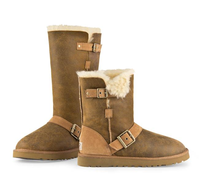 """This undated image provided by Ugg, shows a Dylyn Tall and Short Ugg boot in Chestnut Bomber. A closet full of beautiful boots and gravity-defying heels, flat-foot, furry Uggs weren't at the top of celebrity stylist-designer Rachel Zoe's shopping list. But""""Once you put them on, you can't go back,"""" Zoe says. """"In my house, it's now the family at-home shoe. I wear them all the time. My son has 10 pairs and my husband has 10 pairs."""" (AP Photo/Ugg)"""