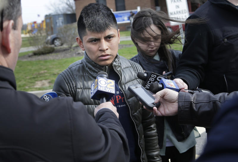 William Tigre talks to reporters at a crime scene where the bodies of four men were found in Central Islip, N.Y., Thursday, April 13, 2017. Tigre said an acquaintance told him Wednesday night that his 18-year-old brother, Jorge, was one of the victims. Police say they're investigating the disappearance of Jorge Tigre, but would not comment on whether the teenager was among those killed. (AP Photo/Seth Wenig)